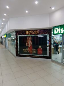 Grapevine media in store advertising Lightbox design Sexy Ruby perfume Dischem window